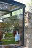 Cafe, with glass curtain wall and roof where it meets the stone masonry