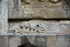 Detail, base relief carving of serpent head in profile, with a forked tongue