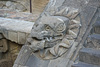 Detail, serpent head on left stair railing with the feathered collar (headdress)