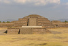 Low central platform, Adosada platform and top of Temple of the Feathered Serpent pyramid beyond, on center axis